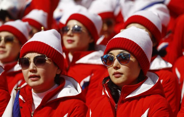 Alpine Skiing - Pyeongchang 2018 Winter Olympics - Men's Giant Slalom - Yongpyong Alpine Centre - Pyeongchang, South Korea - February 18, 2018 - North Korean cheerleaders watch the Men's Giant Slalom. REUTERS/Kai Pfaffenbach