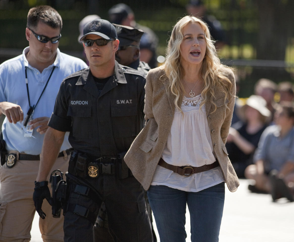 Actress Daryl Hannah is arrested by U.S. Park Police in front of the White House in Washington, Tuesday, Aug. 30, 2011, during a protest against the Keystone oil pipeline. (AP Photo/Evan Vucci)
