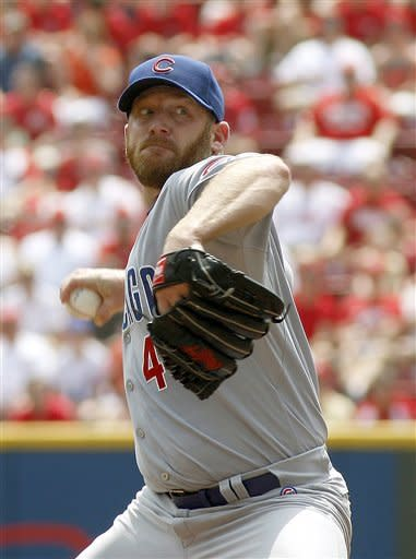 Chicago Cubs starting pitcher Ryan Dempster throws against the Cincinnati Reds during the first inning of a baseball game Thursday, May 3, 2012, in Cincinnati. (AP Photo/David Kohl)