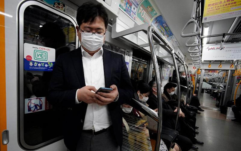 Japan has been criticised for its lack of quarantine time for returning passengers - FRANCK ROBICHON/REX