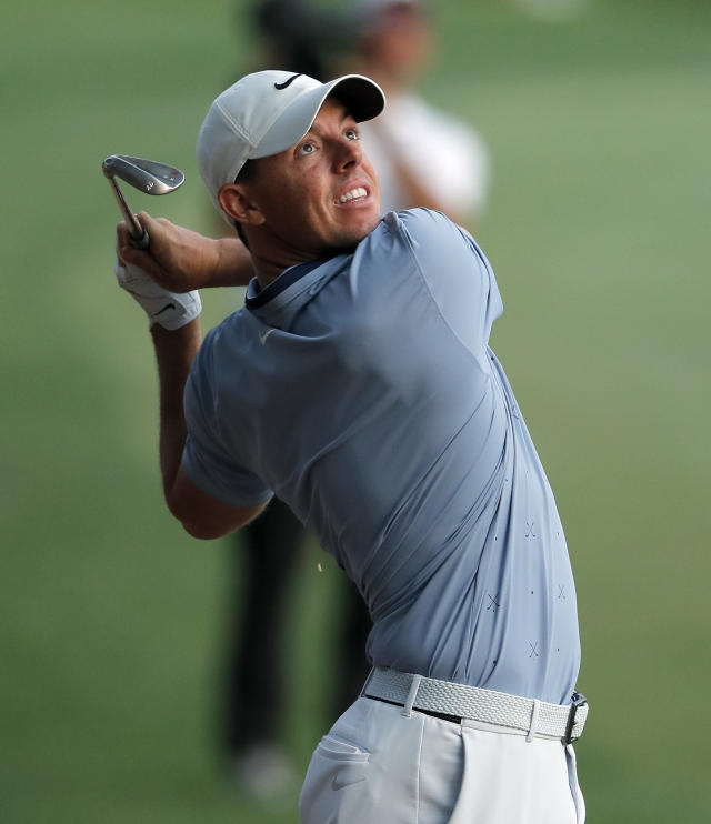 Rory McIlroy, of Northern Ireland, watches a shot from the 18th fairway during the second round of The Players Championship golf tournament Friday, March 15, 2019, in Ponte Vedra Beach, Fla. (AP Photo/Gerald Herbert)