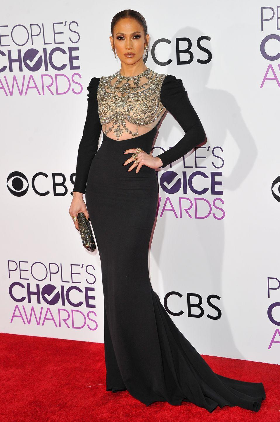 <p>Even a long-sleeved black gown will be jazzed up a bit if worn by Lopez. She wore this black Reem Acra dress with a beaded bodice detail in 2017.</p>