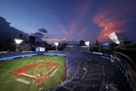 <p>YOKOHAMA, JAPAN - AUGUST 02: The sun sets as Team Japan and Team United States line up for national anthems prior to the knockout stage of men's baseball on day ten of the Tokyo 2020 Olympic Games at Yokohama Baseball Stadium on August 02, 2021 in Yokohama, Kanagawa, Japan. (Photo by Yuichi Masuda/Getty Images)</p>