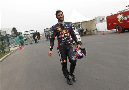 Red Bull Formula One driver Mark Webber of Australia returns to the garage area after retiring from the race during the Indian F1 Grand Prix at the Buddh International Circuit in Greater Noida, on the outskirts of New Delhi, October 27, 2013. REUTERS/Adnan Abidi