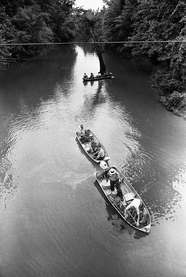 <p>The Pearl River near Philadelphia was dragged for a trace of the missing civil rights workers last seen on Sunday,June 27, 1964. Three boats manned by state and FBI agents only found a missing newspaper box. (Photo: Jab/AP) </p>