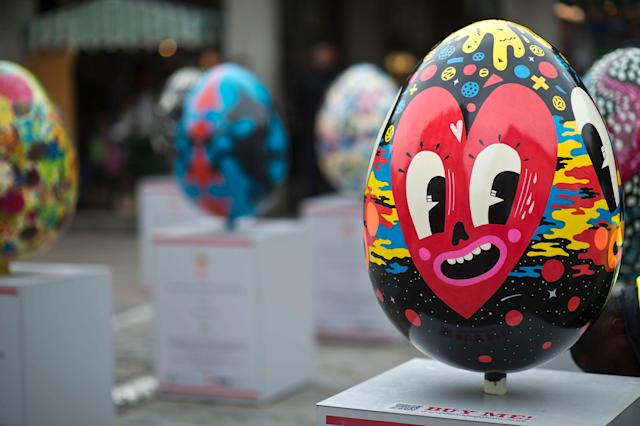 LONDON, ENGLAND - MARCH 22: A giant fibreglass easter egg called 'Hello Cheeky' by Hattie Stewart is displayed in Covent Garden before the Big Egg Hunt on March 22, 2013 in London, England. Each egg is two and a half feet tall and designed by a leading artist. (Photo by Bethany Clarke/Getty Images)