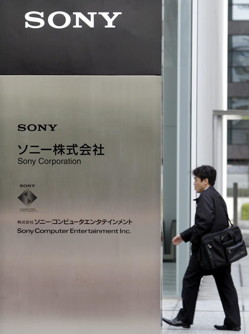 FILE - In this March 10, 2011 file photo, a man heads to the headquarters of Sony Corp. in Tokyo. Sony said on Monday May 2, 2011 that hackers may have taken personal information from an additional 24.6 million user accounts after a review of the recent PlayStation Network breach found an intrusion at a division that makes multiplayer online games. (AP Photo/Koji Sasahara, File)