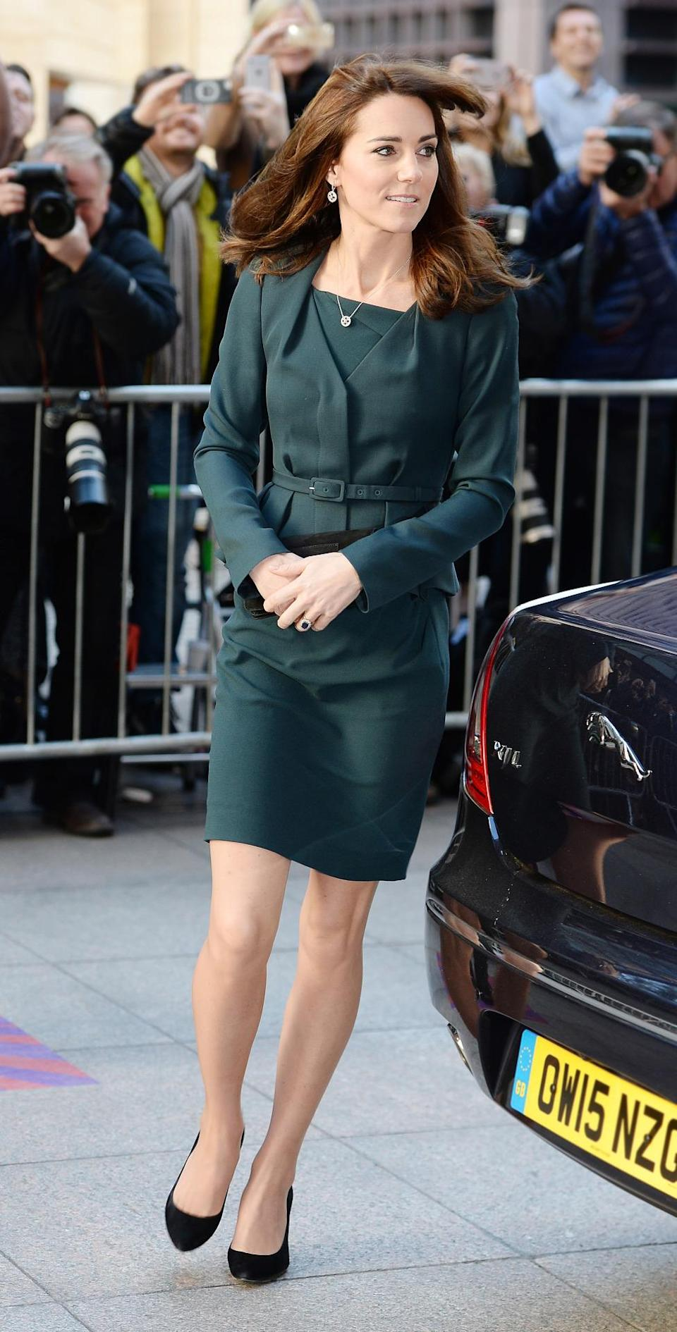 <p>For another charity event with William, Kate chose a dark green suit by British retailer, L.K. Bennett. Her shoes and bag were again designed by Stuart Weitzman and Mulberry respectively. </p><p><i>[Photo: PA]</i></p>