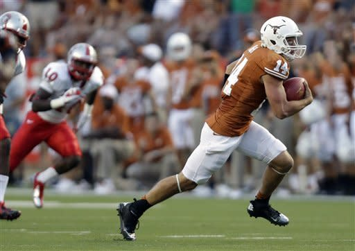 Texas quarterback David Ash (14) scores a rushing touchdown against New Mexico during the first quarter of an NCAA college football game on Saturday, Sept. 8, 2012, in Austin, Texas. (AP Photo/Eric Gay)