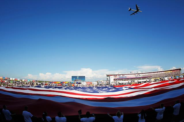 CONCORD, NC - MAY 27: A B-52 flies over a giant American flag held in the infield during the national anthem prior to the NASCAR Sprint Cup Series Coca-Cola 600 at Charlotte Motor Speedway on May 27, 2012 in Concord, North Carolina. (Photo by Chris Graythen/Getty Images)