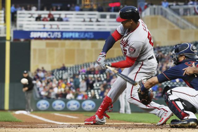 Washington Nationals' Juan Soto hits an RBI single off Minnesota Twins pitcher Martin Perez during the first inning of a baseball game Wednesday, Sept. 11, 2019, in Minneapolis. (AP Photo/Jim Mone)