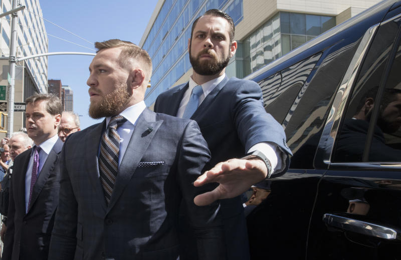Mixed martial arts fighter Conor McGregor leaves a Brooklyn Supreme court, Thursday, June 14, 2018, in New York. McGregor is in plea negotiations to resolve charges stemming from a backstage melee at a Brooklyn arena. The 29-year-old Irish fighter and co-defendant Cian Cowley remained free on bail after a brief court appearance on Thursday. They are due back in court July 26. (AP Photo/Mary Altaffer)