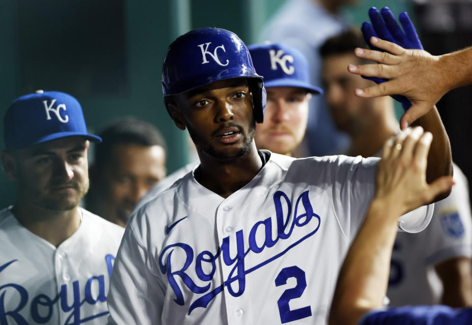 Kansas City Royals' Michael A. Taylor is congratulated in the dugout after hitting a home run during the fifth inning of a baseball game against the Seattle Mariners at Kauffman Stadium in Kansas City, Mo., Saturday, Sept. 18, 2021. (AP Photo/Colin E. Braley)