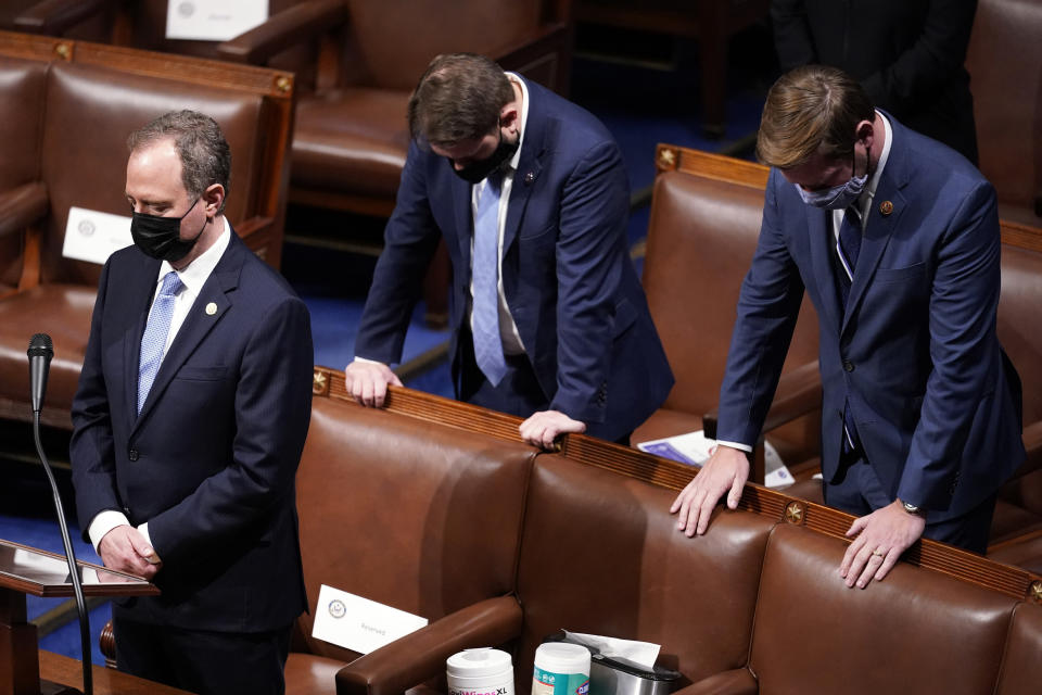 Rep. Adam Schiff, D-Calif., left, bows his head during a closing prayer of a joint session of the House and Senate to confirm Electoral College votes at the Capitol, early Thursday, Jan 7, 2021, in Washington. (AP Photo/Andrew Harnik)