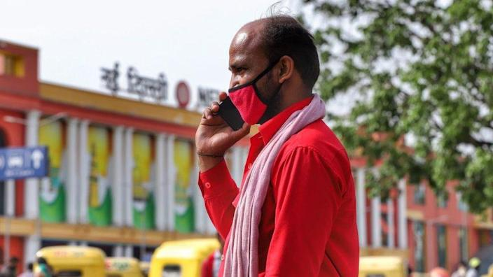 Man on Phone outside a Railway Station in New Delhi, India