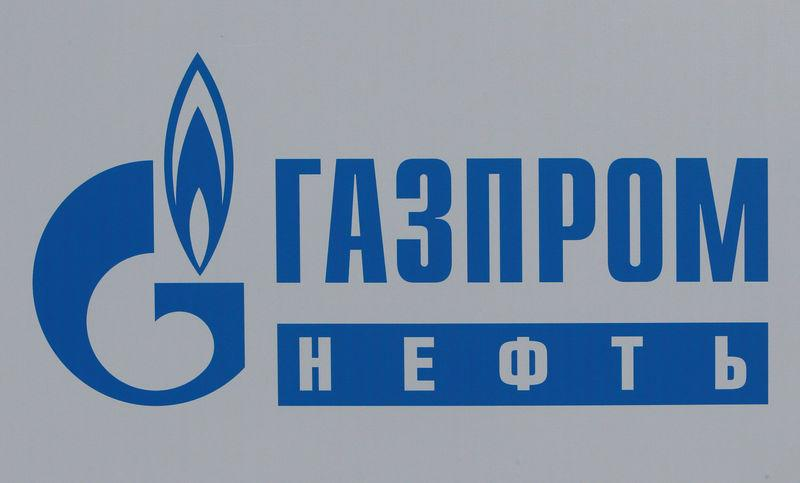 bFILE PHOTO: The logo of Russia's oil producer Gazprom Neft is seen on a board at the SPIEF 2017 in St. Petersburg