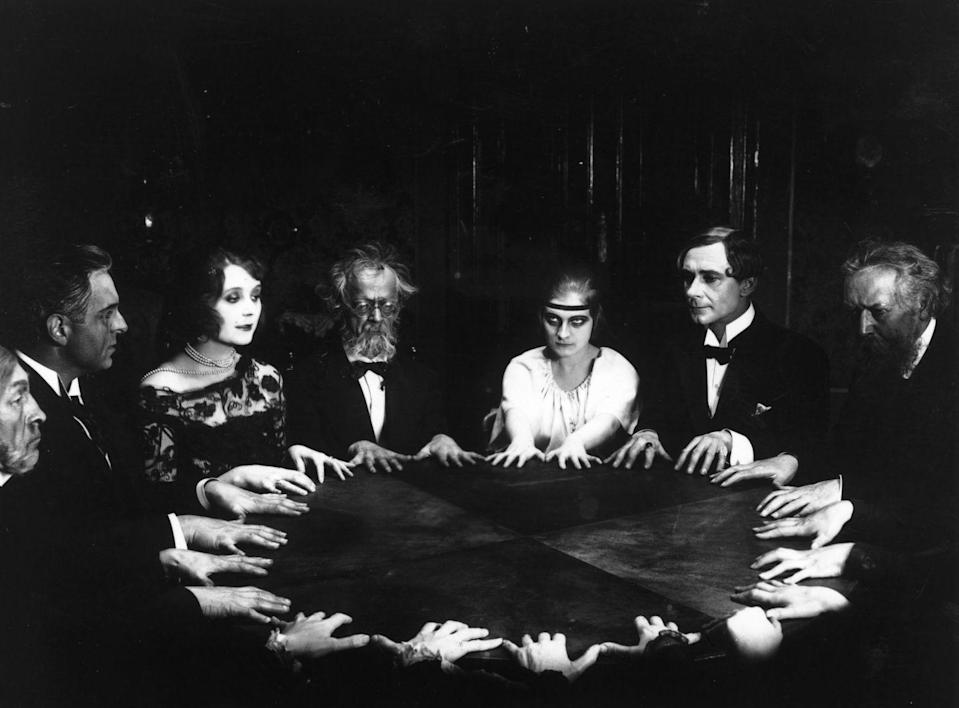 "<p>In a scene from the 1922 German film<em> Dr. Mabuse, Der Spieler</em>, a group of people gather around for a spiritual seance in an attempt to communicate with the dead. According to<em> IMDB</em>, <a href=""https://www.imdb.com/title/tt0013086/trivia?ref_=tt_trv_trv"" rel=""nofollow noopener"" target=""_blank"" data-ylk=""slk:the film is featured in the book"" class=""link rapid-noclick-resp"">the film is featured in the book</a> <em>1001 Movies You Must See Before You Die.</em></p>"