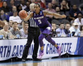 Kansas State's Barry Brown (5) saves a ball from going out of bounds during the first half of a first-round game against Creighton in the NCAA men's college basketball tournament in Charlotte, N.C., Friday, March 16, 2018. (AP Photo/Gerry Broome)