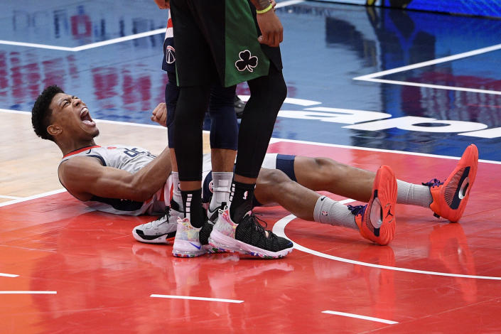 Washington Wizards forward Rui Hachimura (8), of Japan, reacts after he scored and was fouled during the first half of an NBA basketball game against the Boston Celtics, Sunday, Feb. 14, 2021, in Washington. (AP Photo/Nick Wass)