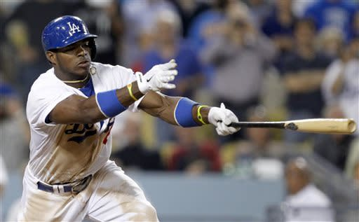 Los Angeles Dodgers' Yasiel Puig hits a two-RBI single against the Philadelphia Phillies in the eighth inning during a baseball game Thursday, June 27, 2013, in Los Angeles. (AP Photo/Alex Gallardo)