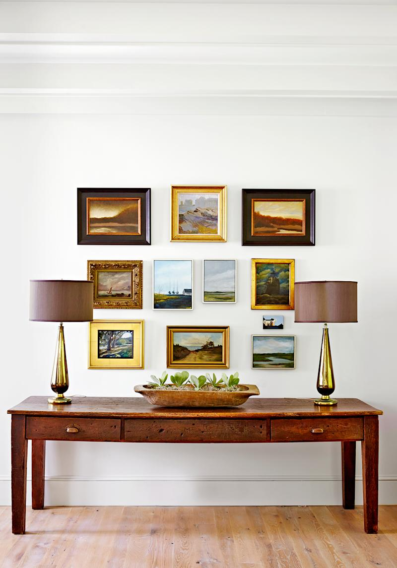 Wooden table multiple picture frames lamps