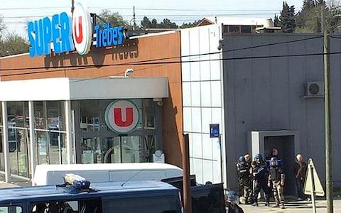police gather outside a supermarket in Trebes - Credit: AP