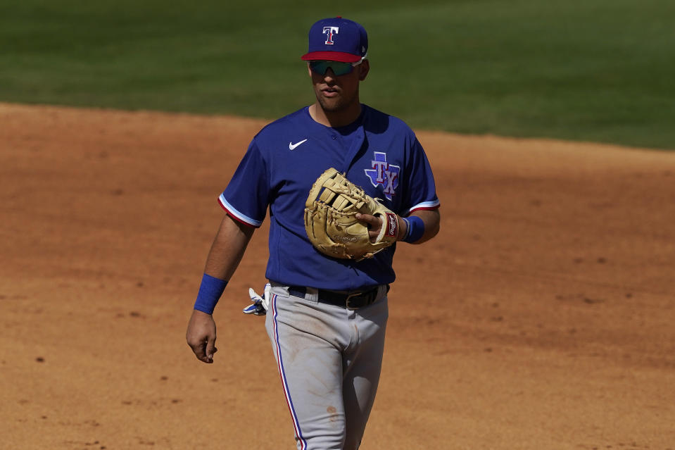 Texas Rangers first baseman Nate Lowe during the second inning of a spring training baseball game against the Los Angeles Angels, Wednesday, March 3, 2021, in Tempe Ariz. (AP Photo/Matt York)