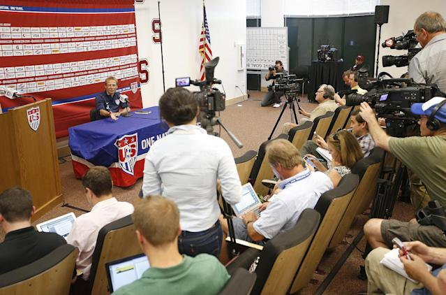 CORRECTS NAME TO KLINSMANN - U.S. Men's National Team Head Coach Jurgen Klinsmann answers questions during a news conference on Wednesday, May 14, 2014, Stanford, Calif. The US national soccer team kicked off its preparation camp at Stanford University preparing for the World Cup tournament, which gets underway in June. (AP Photo/Tony Avelar)