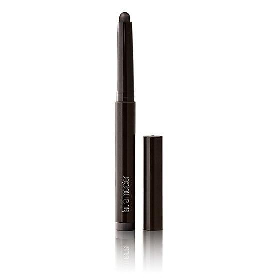 "<p>Draw on your triangular shape using a crayon with a creamy formula packed with fine shimmers like that of the <a href=""https://www.popsugar.com/buy/Laura-Mercier-Caviar-Stick-Eye-Colour-486726?p_name=Laura%20Mercier%20Caviar%20Stick%20Eye%20Colour&retailer=lauramercier.com&pid=486726&price=29&evar1=bella%3Aus&evar9=46571155&evar98=https%3A%2F%2Fwww.popsugar.com%2Fbeauty%2Fphoto-gallery%2F46571155%2Fimage%2F46571156%2FDraw-Triangular-Shapes-With-Eye-Shadow-Stick&list1=makeup%2Cbeauty%20products%2Cbeauty%20interview%2Cfall%20beauty%2Cbeauty%20by%20popsugar&prop13=mobile&pdata=1"" rel=""nofollow"" data-shoppable-link=""1"" target=""_blank"" class=""ga-track"" data-ga-category=""Related"" data-ga-label=""https://www.lauramercier.com/makeup/eyes-eyebrows/eye-shadow/caviar-stick-eye-colour-prod450002.html"" data-ga-action=""In-Line Links"">Laura Mercier Caviar Stick Eye Colour</a> ($29) or the ones by CoverGirl and Nars, ahead.</p>"
