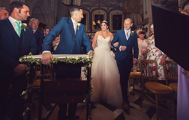Paralysed groom James Thorpe stands at the aisle. Photo: Mega