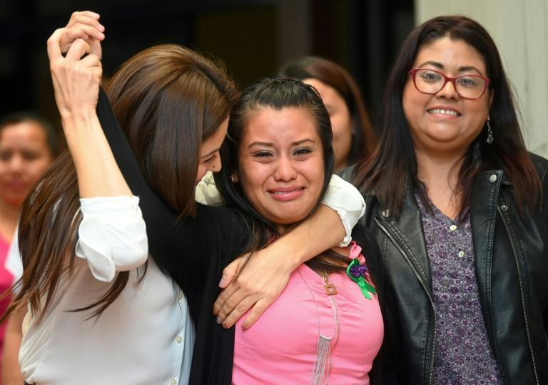 Rape victim Evelyn Hernandez (C) celebrates with her lawyers after being cleared of murdering her stillborn baby, at the Ciudad Delgado court in San Salvador on August 19, 2019