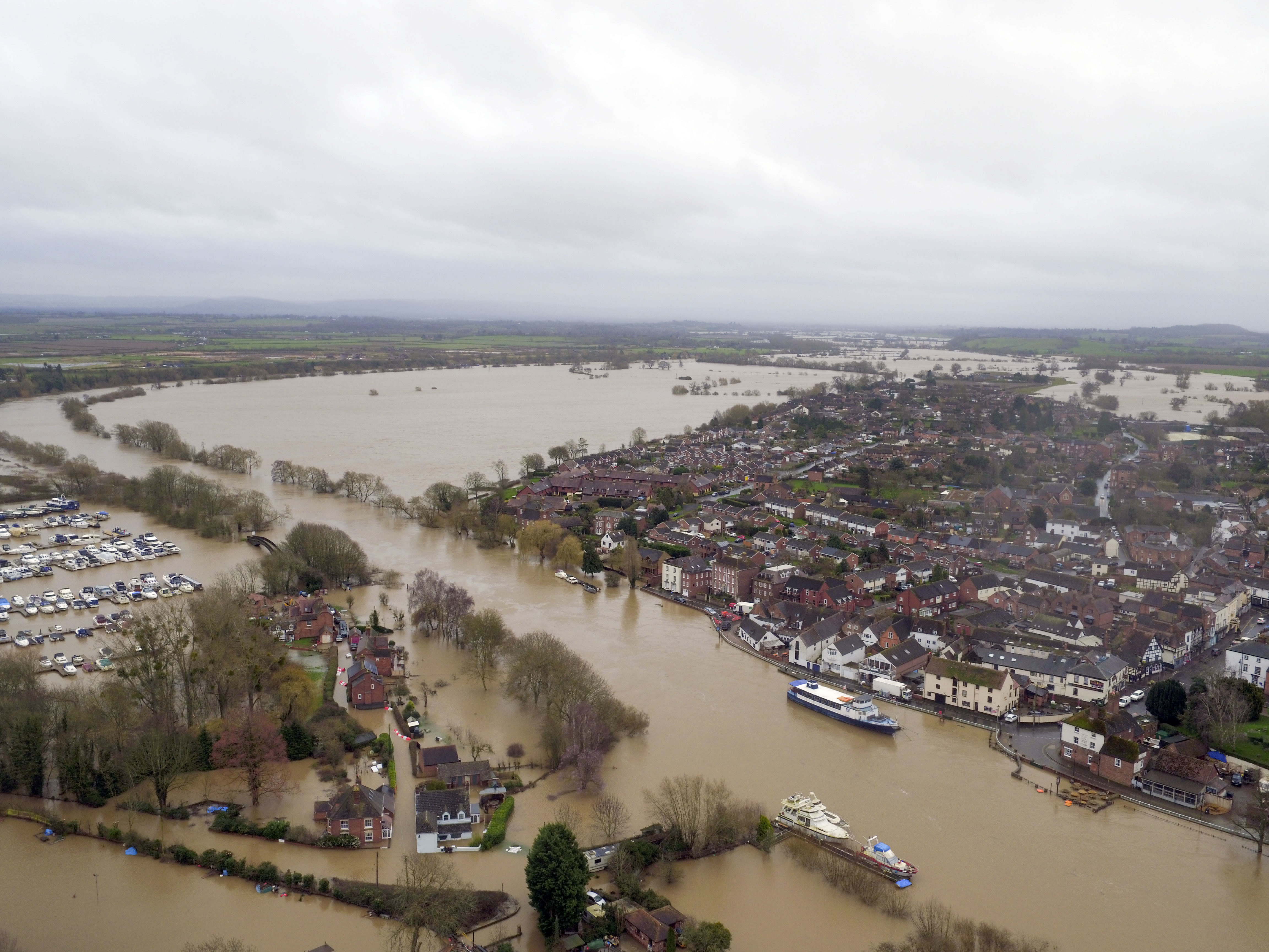 """Flood water continues to surround Upton-upon-Severn, Worcestershire, in the aftermath of Storm Dennis. PA Photo. Picture date: Thursday February 20, 2020. Those already battling with the aftermath of several days worth of rain have been told to expect even more, with pockets of North Wales, northern England and Scotland among those in line for further deluges. The Environment Agency (EA) warned there is a """"heightened flood risk"""" across the Midlands, while there are six severe flood warnings - meaning a danger to life - in place around the Rivers Lugg, Severn and Wye. The lower Avon also remains especially high. See PA story WEATHER Storm. Photo credit should read: Steve Parsons/PA Wire"""