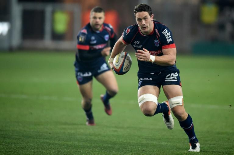 Grenoble's Rory Grice -- seen here running with the ball during a 2016 French league match against Montpellier -- has been been charged with gang rape