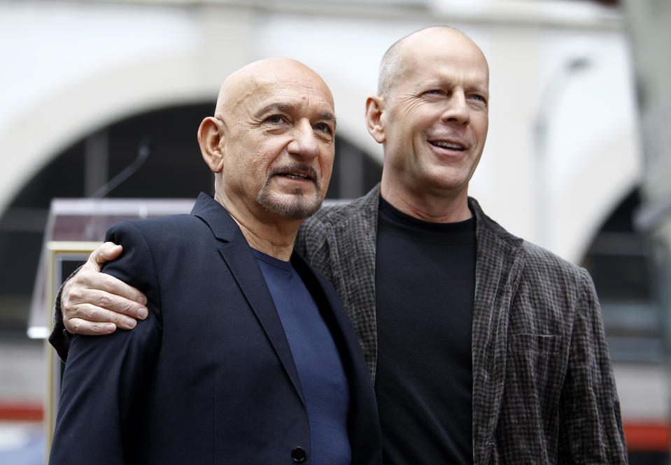 """Actor Ben Kingsley (L) poses with actor Bruce Willis after accepting a star on the """"Walk of Fame"""" in Hollywood, California May 27, 2010. REUTERS/Mario Anzuoni (UNITED STATES - Tags: ENTERTAINMENT)"""