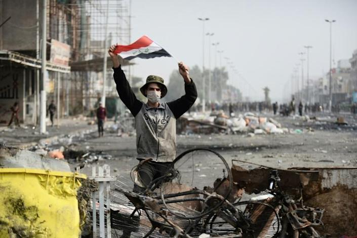 The demonstrators say it will take more than a change of prime minister to address Iraq's woes (AFP Photo/Haidar HAMDANI)
