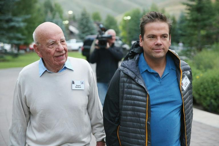 Lachlan Murdoch, who shares the title of executive chairman of 21st Century Fox with his father Rupert Murdoch (L), has said the company is committed to a deal to sell key assets to Walt Disney Co