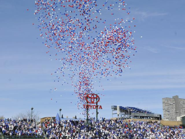 CHICAGO, IL - APRIL 23: As fans sing happy birthday to the ballpark balloons are released during the fourth inning of a game between the Chicago Cubs and the Arizona Diamondbacks on April 23, 2014 at Wrigley Field in Chicago, Illinois. Today marks the 100th anniversary of the first game ever played in the historic venue. (Photo by David Banks/Getty Images)