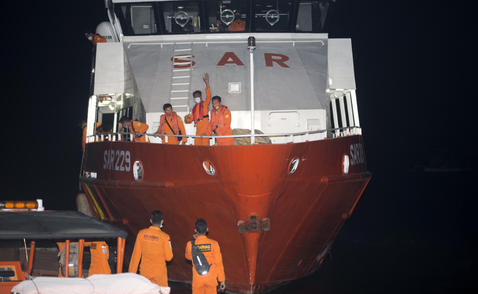 Members of the Indonesian navy helping the search for the missing submarine.
