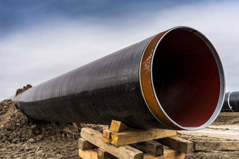 A close-up of a gas pipeline under construction.