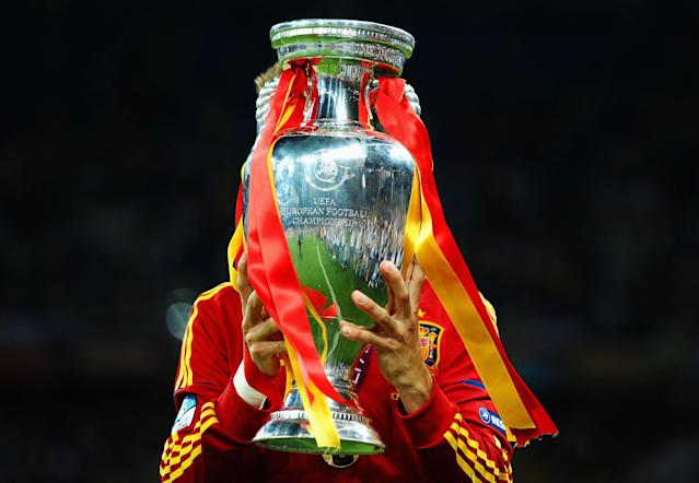 KIEV, UKRAINE - JULY 01: Gerard Pique of Spain kisses the trophy following victory in the UEFA EURO 2012 final match between Spain and Italy at the Olympic Stadium on July 1, 2012 in Kiev, Ukraine. (Photo by Laurence Griffiths/Getty Images)