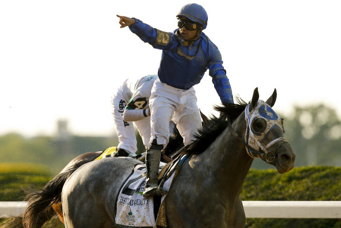 Jockey Luis Saez reacts after crossing the finish line atop Essential Quality (2) to win the 153rd running of the Belmont Stakes horse race, Saturday, June 5, 2021, At Belmont Park in Elmont, N.Y. (AP Photo/Eduardo Munoz Alvarez)