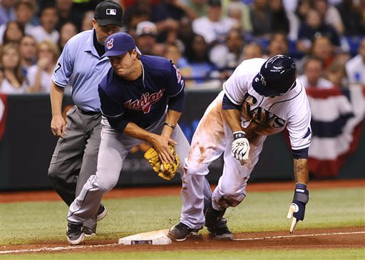 Tampa Bay Rays Desmond Jennings, right, steals third base ahead of Cleveland Indians third baseman Lonnie Chisenhall during the third inning of a baseball game on Saturday, April 6, 2013, in St. Petersburg, Fla. (AP Photo/Brian Blanco)