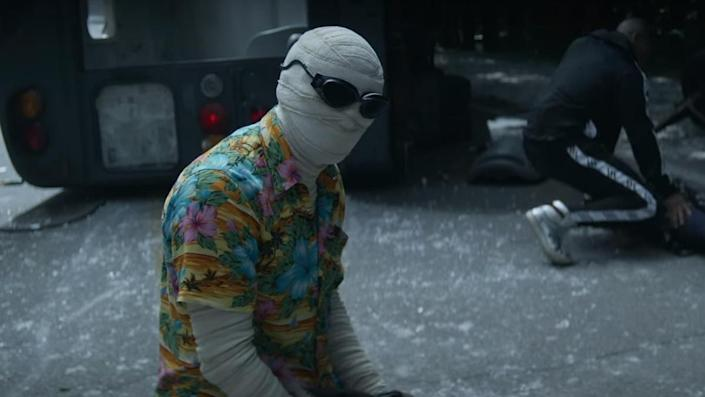 Mr. Negative wears a Hawaiian shirt and looks very sad and despondent while Cyborg crouches in the background in the season three trailer for Doom Patrol.