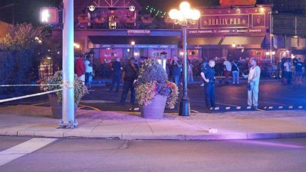 PHOTO: A large police presence stands outside the Dublin Pub in Dayton, Ohio, where a shooting happened in downtown's Oregon District in the early morning hours of Sunday, Aug. 4, 2019. (WKEF)