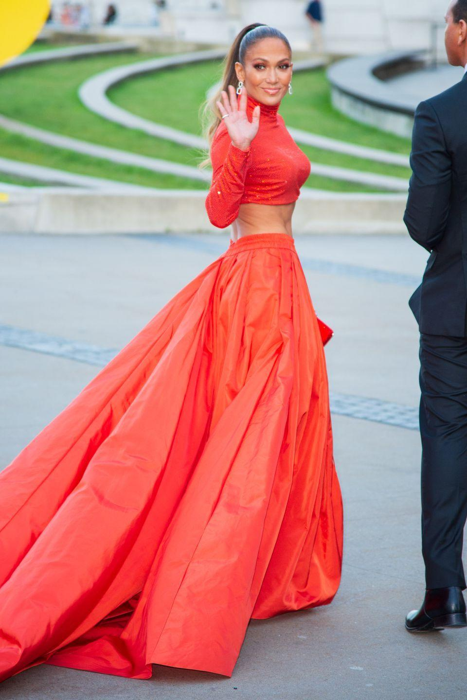 "<p>J.Lo pulls up to the CFDA Fashion Awards at the Brooklyn Museum in a bright-orange, ab-baring crop top and skirt by Ralph Lauren Collection. Also important? Her 'fit had a casual <a href=""https://www.elle.com/culture/celebrities/a27705252/jennifer-lopez-dress-cfda-fashion-awards-2019/"" rel=""nofollow noopener"" target=""_blank"" data-ylk=""slk:43,200 crystals"" class=""link rapid-noclick-resp"">43,200 crystals</a> on it. </p>"
