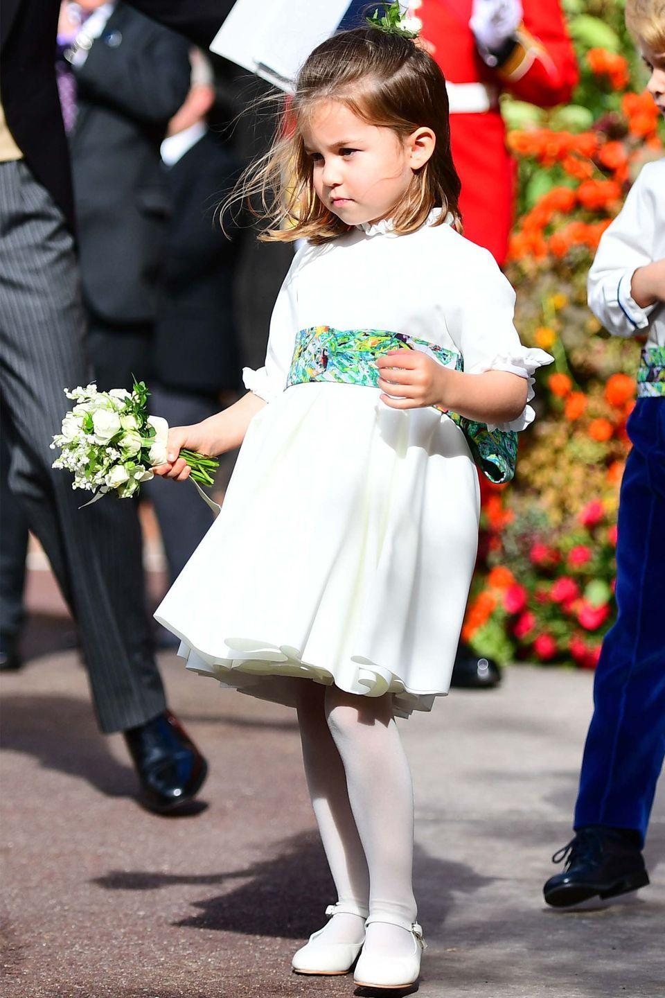 <p>The little royal is nothing short of regal showing off her white dress and mini bouquet. </p>