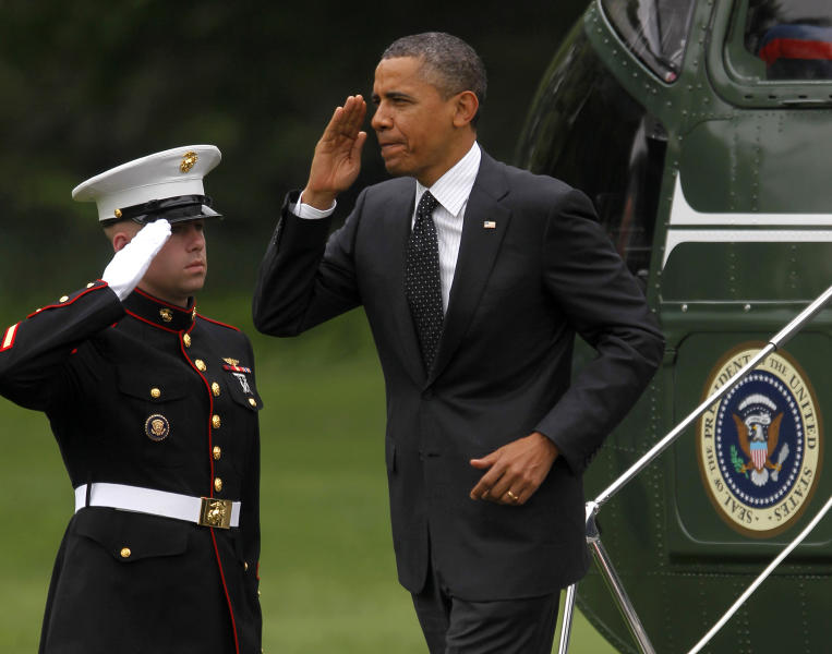 President Barack Obama returns a salute as he steps off the Marine One helicopter upon his arrival on the South Lawn of the White House in Washington, Wednesday, May, 2, 2012. Obama was returning from an unannounced trip to Afghanistan.(AP Photo/Pablo Martinez Monsivais)