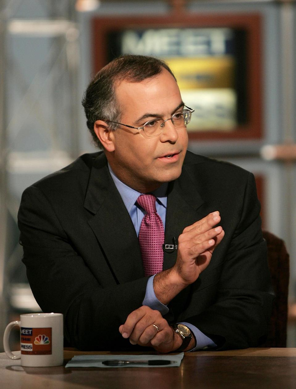 <p>WASHINGTON - SEPTEMBER 25:  New York Times columnist, David Brooks, gestures while speaking on NBC's