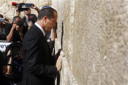 Jerusalem Mayor Nir Barkat prays at the Western Wall in Jerusalem's Old City