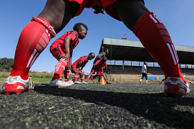 XDI11. Nairobi (Kenya), 29/05/2018.- Players of Lion Stars, Kenya's first dwarf soccer team, warm up during a training session at the City Stadium in Nairobi, Kenya, 29 May 2018 (issued 14 July 2018). Lion Stars is an eight member men's dwarf soccer team, the first of their kind in Kenya, with players aged between 18 and 47 years old. Led by Gabriel Ochieng, a volunteer coach, the team aims transition from a recreational to a competitive one. They are planning to head to Argentina for the Copa Argentina tournament in October 2018 for friendly matches they have been invited to. Dwarf soccer has different rules to the mainstream version, in the interests of player safety. Headers are banned, for instance, to prevent spinal injuries, and if a player heads the ball, the other team will be awarded a free kick. Lion Stars is the only dwarf soccer team in East Africa and is working towards bringing Tanzania, Uganda and Rwanda into the fold. However, the team is facing several challenges, including financial sponsorship that would enable them to further their sporting endeavors. 'We face the challenge of ground, we face a challenge of balls, we face challenge of corns, we face challenge of uniform,' volunteer coach Ochieng said. They have reached out to the Kenyan government and well-wishers for help. The team was established with the help of the 'Short Stature Society of Kenya' to help counter stigmatization against people of short stature in the country by engaging in activities such as motivational speaking, theater, and community work as well as sporting activities such as weight-lifting, badminton and soccer. (Futbol, Amistoso, Kenia, Ruanda) EFE/EPA/DANIEL IRUNGU ATTENTION: This Image is part of a PHOTO SET